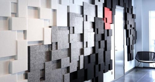 wall with gray and white felt panels for acoustical insulation